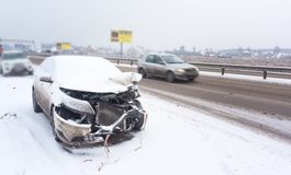 An accident with a white car in winter on road, slippery icy road, danger driving Stock Image