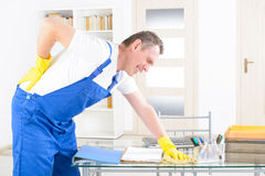 Accident at work. Man worker with back injury, concept of accident at work Stock Photo