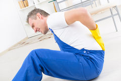 Accident at work. Man worker with back injury, concept of accident at work Royalty Free Stock Image