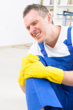 Accident at work. Man worker with knee injury, concept of accident at work Royalty Free Stock Image