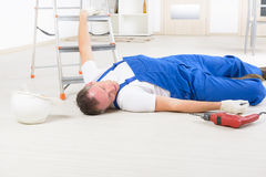 Accident at work. Man worker laying on a floor, concept of accident at work Royalty Free Stock Photography