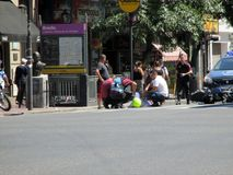 Accident yesterday, February 7, corner Homero Manzi Buenos Aires ArgentinanMotorcyclist fall down the street is assisted by police. And doctorsnnncorner Homero stock images
