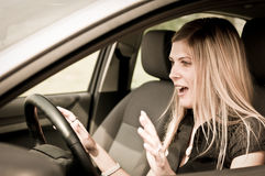 Before accident - young woman driving car Royalty Free Stock Photography