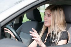 Before accident - young woman driving car Royalty Free Stock Image