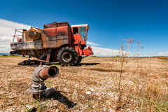Accidental and burned tractor for grain processing Stock Images