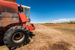 Accidental and burned tractor for grain processing Stock Photography