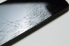 Accidentally cracked, damaged smartphone LCD screen isolated on white background.  royalty free stock photography