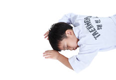 Accidents in sports. Asian child athletes taekwondo lying prone. Accidents in sports. Asian child athletes taekwondo lying in prone position unconscious with Stock Photo