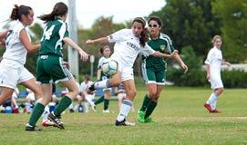 Acción del fútbol de las muchachas Imágenes de archivo libres de regalías
