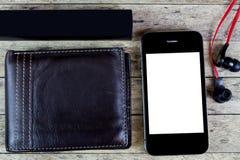 Accione el banco, la cartera, los auriculares y el teléfono elegante Imagenes de archivo
