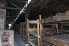 Accommodation in Auschwitz II Birkenau. Bunk beds with three levels for prisoners in Asuchwitz II - Birkenau,  the biggest extermination camp in Europe built by Stock Images