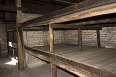 Accommodation in Auschwitz II Birkenau. Bunk beds with three levels for prisoners in Asuchwitz II - Birkenau,  the biggest extermination camp in Europe built by Stock Image