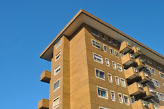 Accommodation. A building of apartments on a blue background Royalty Free Stock Image