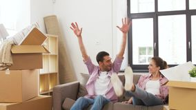 Happy couple with stuff moving to new home stock footage