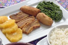 Accompaniments of feijoada served at the table. Accompaniments of feijoada, traditional Brazilian bean stew, served at the table stock photos