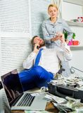 Accomplices financial fraud crime. Man and woman earn money on mobile conversation fraud. Blackmail and money extortion. Accomplices financial fraud crime. Man royalty free stock images