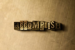 ACCOMPLISH - close-up of grungy vintage typeset word on metal backdrop. Royalty free stock illustration.  Can be used for online banner ads and direct mail Stock Photo