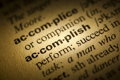 Accomplish. Word Accomplish in a dictionary stock image