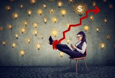 Accomplished business woman relaxing sitting in the office under idea money rain Royalty Free Stock Photo