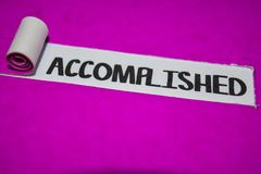 Accomplished text, Inspiration and positive vibes concept on purple torn paper stock photo
