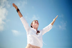 Accomplished Woman. A beautiful woman smiling with arms open Royalty Free Stock Images