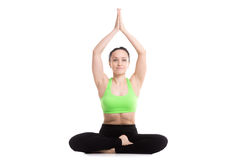 Accomplished yoga pose. Serene happy girl does yoga workout, sitting in Ardha Padmasana, Siddhasana, Accomplished Pose, asana for meditation, breathing, hands royalty free stock images