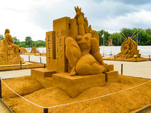 ACCOMPLISSEMENTS de sculpture en sable GRANDS de l'HUMANITÉ Image libre de droits