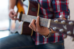 Accord chord, Close up of mens hands playing an acoustic guitar Royalty Free Stock Photography