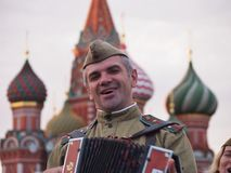 Accordian Player at Saint Basil`s Cathdral Stock Photo