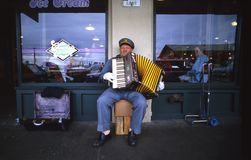 Accordian street musician Stock Photo