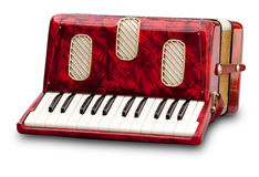 Accordion. Retro small red accordion isolated on white stock photography