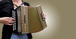 Accordion. Closeup of woman playing traditional accordion royalty free stock photo