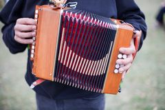 Accordion. A performer with a beautiful old Button Accordion Royalty Free Stock Photography