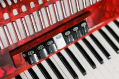 Accordion. Closeup view of a red accordion royalty free stock photography