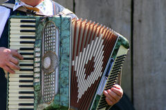 Accordion. Music by a man on the accordion Royalty Free Stock Image