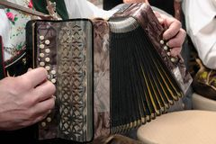 Accordion. German man's hands playing a traditional accordion royalty free stock photo
