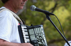 Accordion. Man singing and playing a accordion Stock Photo