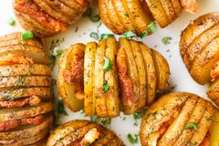 Accordion baked potatoes with bacon Stock Photos
