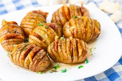 Accordion baked potatoes with bacon Royalty Free Stock Images