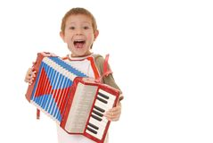 Accordion Boy 11. Isolated young boy playing a diatonic accordion Stock Images