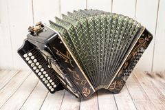 Accordion with furs spread out. Russian folk musical instrument royalty free stock photo
