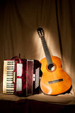 Accordion and guitar. Retro accordion and acoustic guitar royalty free stock images