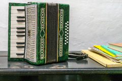 Accordion. The historic Accordion and books with notes royalty free stock images