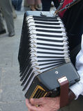 Accordion player. Old man playing accordion stock photos