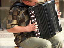 Accordion player. Man playing accordion royalty free stock photos