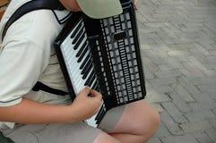 Accordion Player. Boy playing accordion stock photography