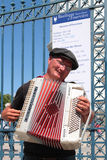 Accordion player. LYON, FRANCE, MAY 31, 2014 : Unidentified musician plays accordion in front of Basilica of Fourviere. Fourviere hill and the Basilica are the stock image