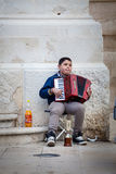 Accordion player, poor child busker Stock Photography