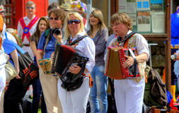 Accordion players. Accompanying Morris dancing at the Rushcart Ceremony in Saddleworth, UK on 20th of August, 2011 Royalty Free Stock Image