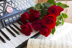 Accordion and red roses. Photo with notes, accordion and red roses stock photo